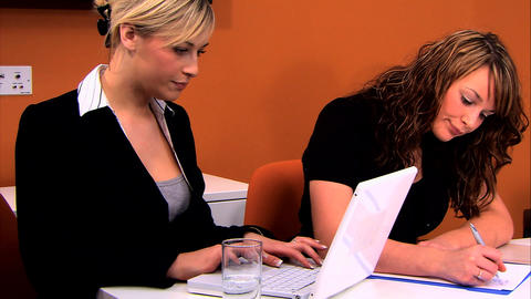 Attractive businesswomen working at the office together Stock Video Footage