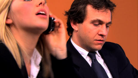 Businesswoman and businessmen using technology in the... Stock Video Footage