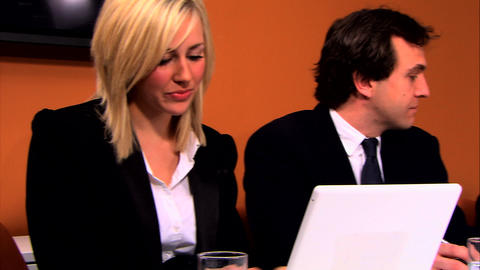 Ambitious business people using technology in the office environment Footage