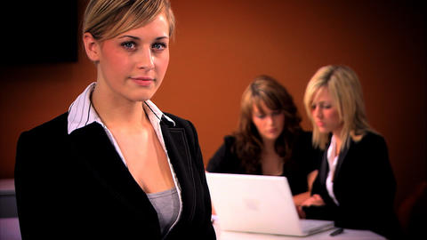 Blonde businesswoman with team in background Footage