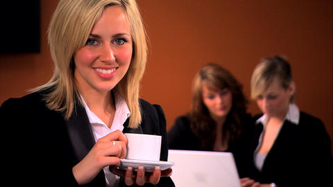 Attractive businesswoman with team in background Footage
