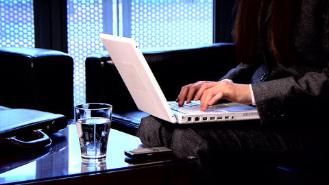 Businesswoman on laptop and mobile Stock Video Footage