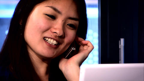 Attractive Japanese businesswoman working in the home office Stock Video Footage