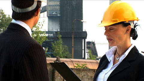 Environmental officers visiting industrial site for... Stock Video Footage