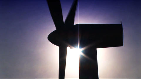 Wind power farm producing energy in the environment Stock Video Footage