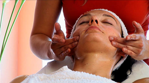 Beautiful brunette girl having facial massage at the beauty spa Footage