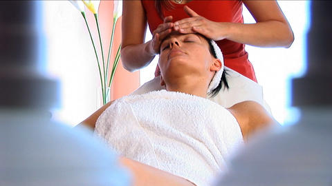 Young brunette having facial massage at beauty spa with... Stock Video Footage
