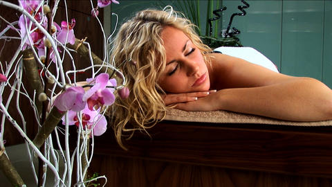 Beautiful blonde girl having hot stones massage treatment... Stock Video Footage