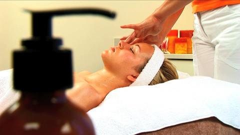 Beautiful blonde girl having facial massage at beauty spa... Stock Video Footage