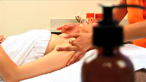 Beautiful blonde girl at health spa having massage... Stock Video Footage