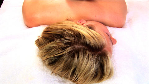 Beautiful blonde girl having hot stone massage at health... Stock Video Footage