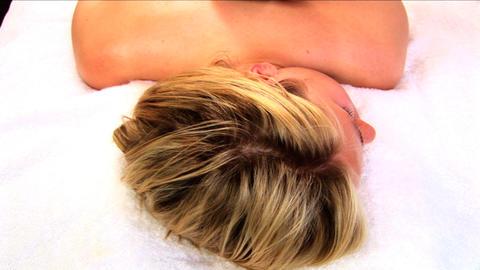 Beautiful blonde girl having hot stone massage at health... Stock Video Footage