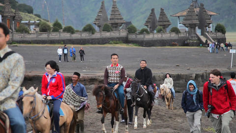 Tourists walking at Bromo volcano Stock Video Footage