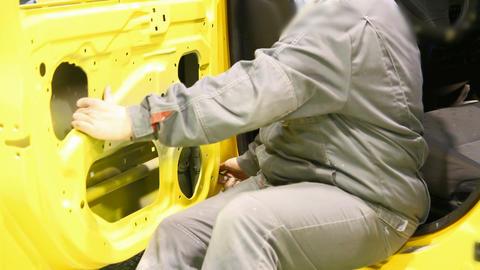 Car's door installation Stock Video Footage
