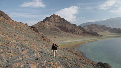 Mountain Hiking in Mongolian Altai at Tolbo Nuur lake Stock Video Footage