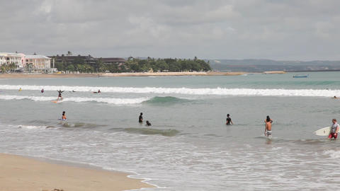 Surfers on the Kuta beach Stock Video Footage