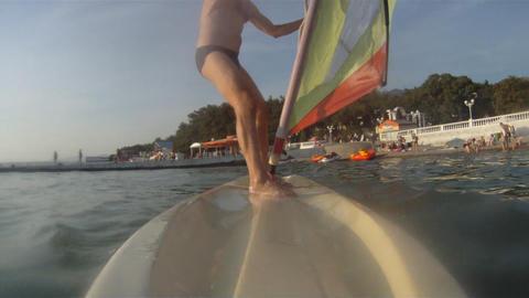 Mature man on the windsurf Stock Video Footage