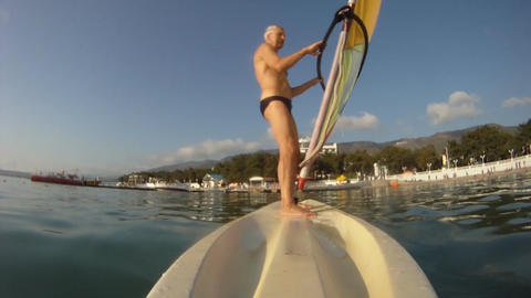 Mature man on the windsurf Stock Video Footage