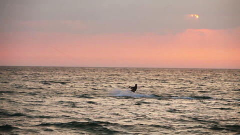 Kite surfer sailing on the sea at sunset Footage