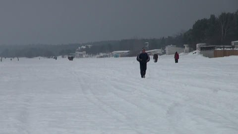 The man running in the snow Stock Video Footage