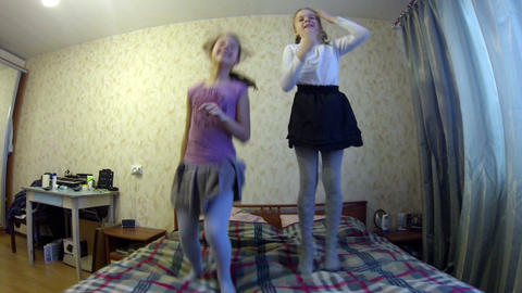 Girls jumping on the bed Stock Video Footage
