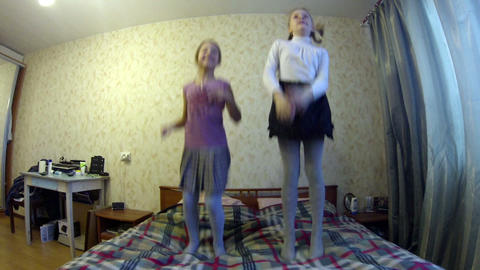 Girls Jumping On The Bed stock footage