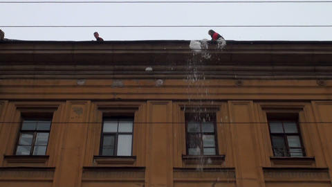 Workers clean the roof from snow Footage