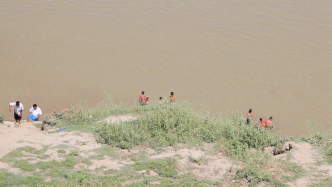 People swimming near Buphaya Pagoda on Irrawaddy River Stock Video Footage