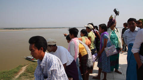 Activity near Buphaya Pagoda on Irrawaddy River Stock Video Footage