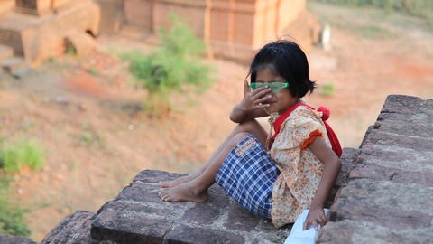 Young souvenir seller in temple in Bagan Stock Video Footage