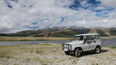 Jeep and fisherman at coastline of Dayan Nuur lake Stock Video Footage