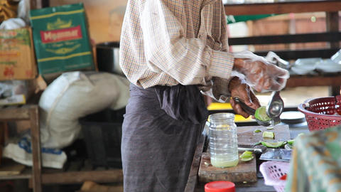 A man prepares a juice from the lime Footage