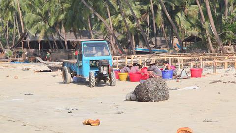 Fishing village sand beach Stock Video Footage