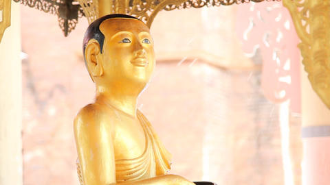 Buddha in Shwezigone pagoda Stock Video Footage