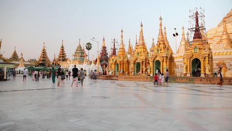 Visitors in Shwedagon Pagoda in the evening Stock Video Footage