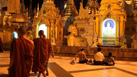 Visitors in Shwedagon Pagoda in the night Stock Video Footage