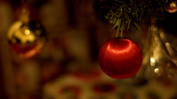 Red Bauble Decoration on a Christmas Tree Footage