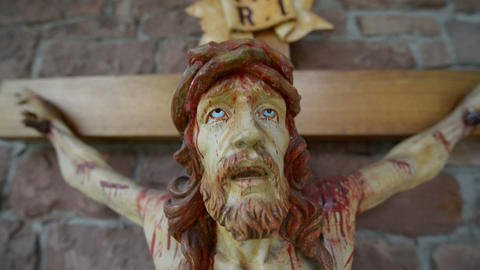 very bloody scary jesus on the cross super close 10930 Stock Video Footage