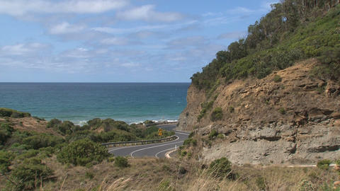 Litte white bus driving down at the Great Ocean Ro Stock Video Footage