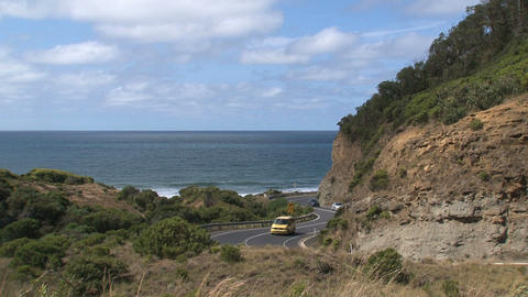 Yellow little fan and cars drives at Great Ocean R Footage