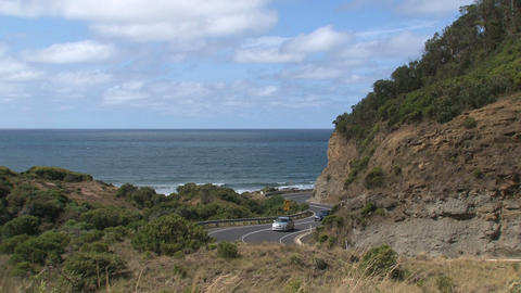 Yellow little fan and cars drives at Great Ocean R Stock Video Footage