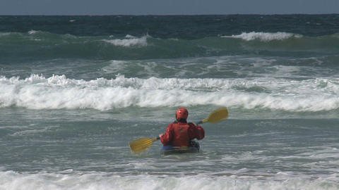 Kayaking against the waves Footage
