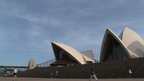 Running infront of the Opera House Stock Video Footage