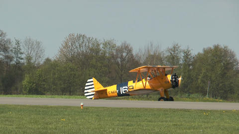 Historic military biplane boeing stearman rolling on taxiway Footage