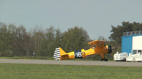 Historic military biplane boeing stearman rolling on taxiway Stock Video Footage