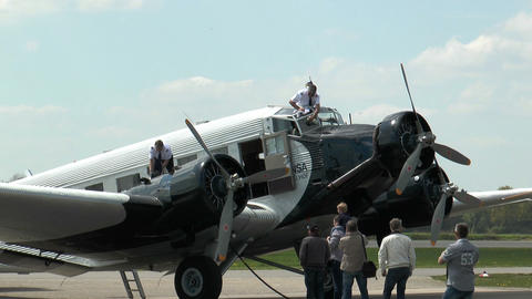 pilot cleans airshield of military plane ju52 Stock Video Footage
