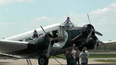 Pilot Cleans Airshield Of Military Plane Ju52 stock footage