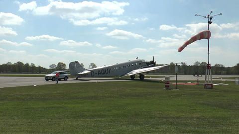 historic military airplane ju 52 drawn by car on taxiway Footage
