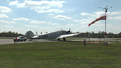 historic military airplane ju 52 drawn by car on taxiway Stock Video Footage