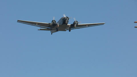 Historic military airplane ju 52 flyover Stock Video Footage
